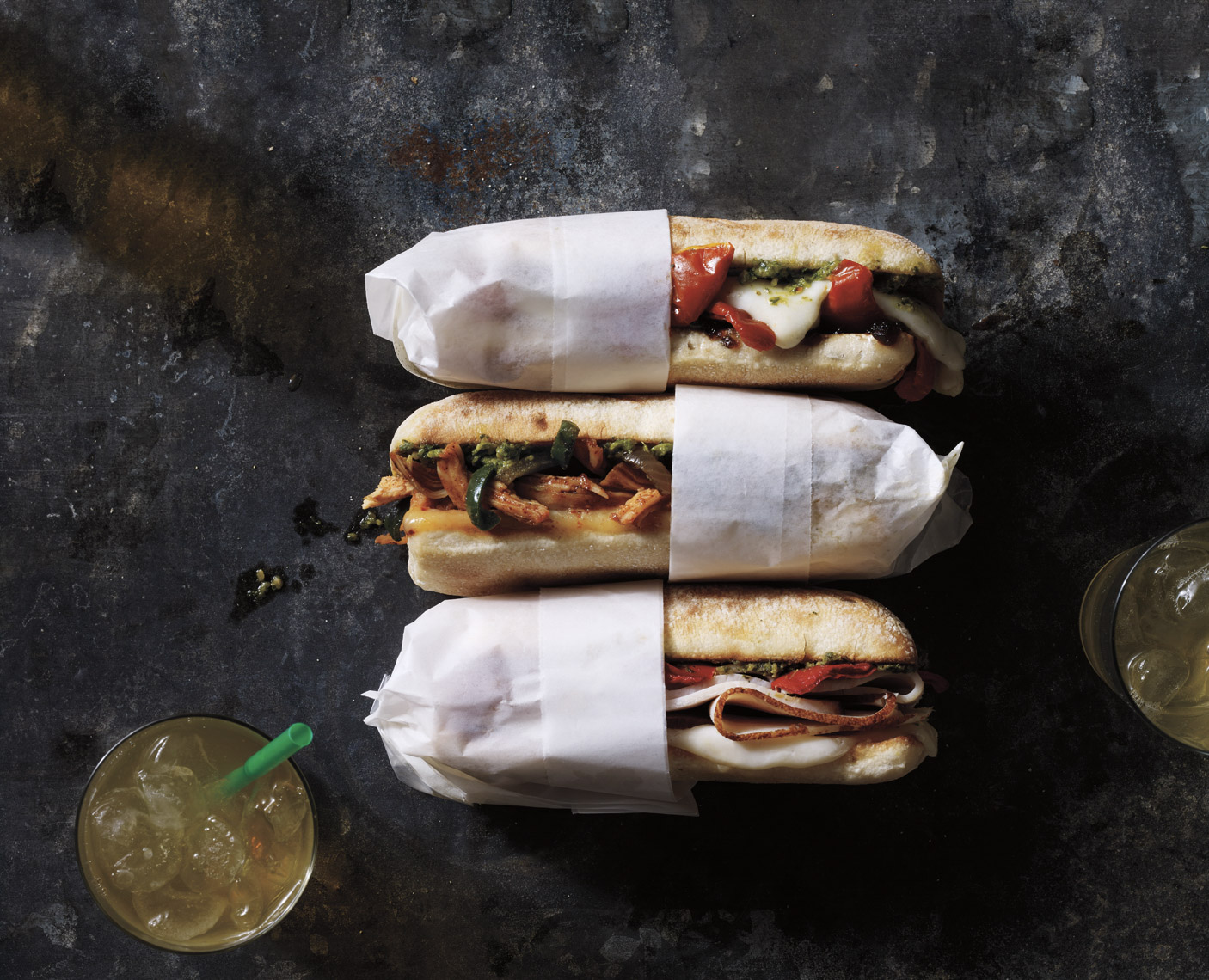 Robyn Valarik San Francisco Based Food & Drink Stylist - Starbucks, pepper, mozzarella, melty, sandwiches, to-go, roll, bun, meat, cheese, vegetables, arugula, wrapped, parchment, stacked, toasted,  food-photography